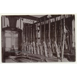 Gun Shop Exhibition: Hunting Rifles & Shotguns (Vintage RPPC Sepia ~1910s/1920s)