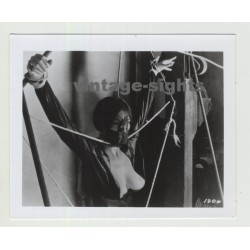 Busty Female In Lacquer Suite Tied In Torture Machine / Mask - BDSM (Vintage Amateur Photo)