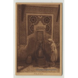 Lehnert & Landrock: A La Fontaine / Arabaian Girl At A Fountain *252