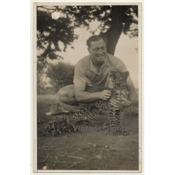 Africa: Man Caresses Young Leopard (Vintage RPPC ~1950s)