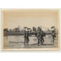 Africa: Kolonialherr Crosses River In Palanquin / Indigenous...