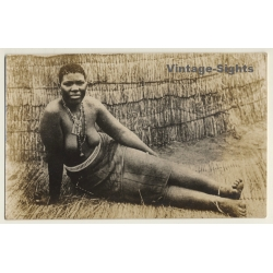 Africa: Topless Indigenous Woman In Front Of Hut / Ethnic...