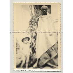 African Man In Traditional Wrapper & White Boy (Vintage Photo B/W Africa ~1940s)