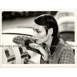 Close-Up Of Woman Leaning Against Parking Meter (Fashion Photo 1980s)